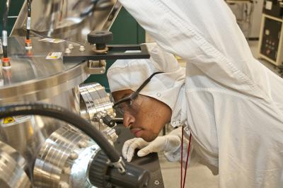 CNF REU intern Austin Little (2014) works with one of the CNF sputtering systems.